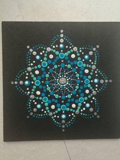 Hand-painted Mandala with acrylic paint in wood