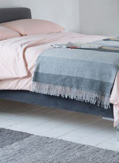 Loaf's grey wool and cashmere Snozzle throw on soft pink linen