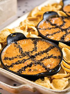 "Garnish the top of this ""Slam Dunk Chili Cheese Dip"" with black olives to make it look like a basket ball. Just in time for March Madness!"