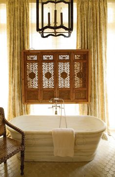 Marble tub, Ming Dynasty carved teak window screen, and toile drapes; Barry Dixon