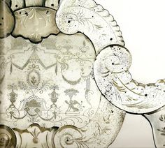 close up of an antique Venetian mirror                                                                                                                                                                                 More