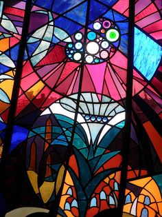 """Stained glass window in the Beijenkorf (""""The Beehive"""") shopping centre. The Hague - Holland. Photo by Frans Schmit."""