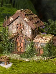 Image result for Fairy house this one is amazingly detailed, built on stump base and well incorporated into the landscape