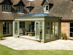 sun room and patio. I love the bi-fold exterior doors! Garden Room, House Design, Garden Room Extensions, Glass Room, House Exterior, Conservatory Extension, Sunroom Designs, Timber Windows, Orangery