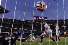 Barcelona's Argentinian forward Lionel Messi (L) scores against Sevilla's goalkeeper Sergio Rico (frontL) during the Spanish league football match FC Barcelona vs Sevilla FC at the Camp Nou stadium in Barcelona on April 5, 2017. / AFP PHOTO / Josep LAGO
