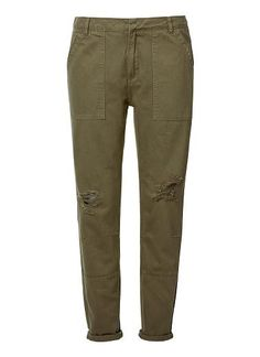 100% Cotton Ripped Bf Cargo Pant. Comfortable cargo style features a fixed waistband with fly and button closure, side patch pockets, front body panels and tapared leg with rips at knees. Available in Army Green as shown.