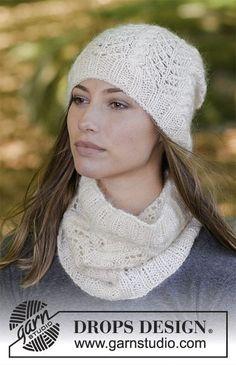 Enrica / DROPS 182-7 - L'ensemble se compose de: bonnet et snood au tricot, avec torsades, point ajouré et côtes. L'ensemble se tricote en DROPS BabyMerino et DROPS Kid-Silk.