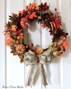 DIY Fall Wreath tutorial with fall leaves, pumpkins, burlap, and Mackenzie Childs ribbon
