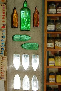Bottles permanently embedded in the wall. Allowing light into the room. An artist's studio in New Zealand.