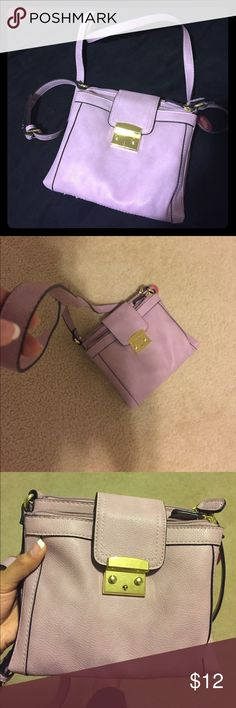 Lavender crossbody bag Light purple/lavender colored crossbody purse. Soft material with gold magnet closure for extra safety of belongings. Never used!! Merona Bags Crossbody Bags