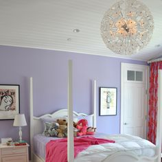 purple girl's room with pops of red