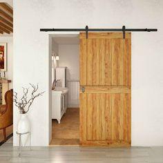 porte coulissante en bois blond, murs blanc neige et sol en parquet contrecollé