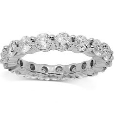 This exquisite womens diamond eternity band is crafted in highly polished 14K White Gold. Seventeen large brilliant round cut diamonds are prong set across the frame which weighs a total of 5.0 grams. Measuring to approximately 1/8 Inches in width, this lovely womens diamond eternity band is an ideal gift which gleams with beauty and elegance. $5,160.00