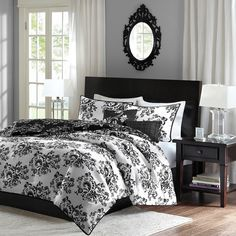 The Leonora collection is updated and versatile for any look you want for your bedroom. A beautiful scroll, floral motif is printed on the front and back of the comforter and sham in contrasting black and white colors. The comforter and sham is fully reversible for you to decorate your bed. The comforter set includes comforter, sham and two decorative pillows.