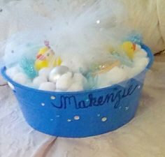 "Handmade diaper gift for shower-diapers are underneath cotton balls, round ""bubble"" ornaments and bath toys."