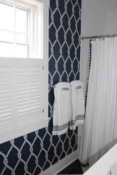 A DIY navy and white stenciled bathroom in a beach home using the Perfect Catch Stencil from Cutting Edge Stencils. http://www.cuttingedgestencils.com/perfect-catch-stencil-beach-decor.html