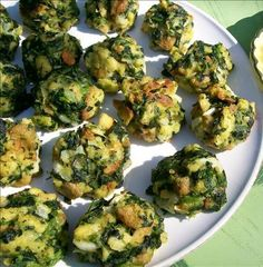 Parmesan Spinach Balls - Per ball: Calories: 33.0 Total Fat: 2.1 g Cholesterol: 23.7 mg Sodium: 73.2 mg Total Carbs: 0.7 g Dietary Fiber: 0.2 g Protein: 1.6 g