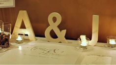 The Jaguar guestbook table, with tealight candles, flowers, initial cut-outs & a custom made guestbook scroll from Mrs Gloss. #Sydney