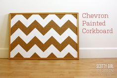 Paint the bulletin board into the wall design. Not chevron but part of the big graphic.