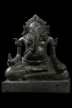 A Seated Bronze figure of Ganesh   Cambodia  12th century  Bronze