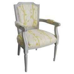 Add a chic focal point to your living room seating goup or breakfast nook with this charming wood arm chair, showcasing a white finish and nature-inspired up...