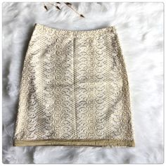 """Final Price ‼️BANANA REPUBLIC  Brocade Lace Skirt Beautiful ivory brocade skirt with metallic gold stitching from Banana Republic. The bottom of the skirt is trimmed in 1"""" of gold satin. The skirt is lined. There is a zipper closure on the side of the skirt. Measurements : Waist : 14 inch, Hips : 16.5 inch, Length : 18.5 inch.                                                                                                                   ✅price is firm unless bundle Banana Republic Skirts…"""