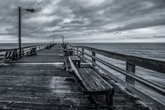 Ahh, the romance of piers in photographs, novels and movies. They evoke many memories - of storms, sunsets, family vacations, loneliness and the power of the ocean. Piers can be warm and inviting. They can also be mysterious and haunting. The same pier captured at the same time by two photographers …