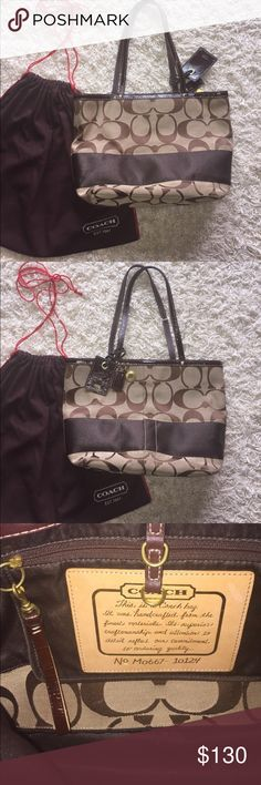 Coach Tote Coach style# M0667-10124. Was purchased from Lord & Taylor. Beautiful tote in great condition! One inner zipper pocket. Tote has a clasp to close. Please feel free to ask questions! Comes with original Coach dust bag. Offers welcome! Coach Bags Totes