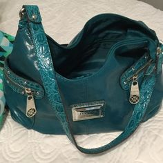 Nicole Miller purse SALE⚡️ Great bag with lots of pockets. Not sure if it's real leather. Teal. There is a pocket inside as well. Nicole by Nicole Miller Bags Shoulder Bags