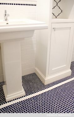 Navy penny tile tall thin cabinet next to pedestal sink.  Use reverse in half bath.