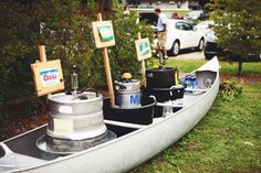 Rustic Camp Style Wedding- like the canoe for cooler idea filled with ice with cans & bottles also