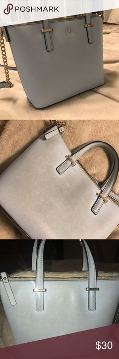 Kate spade bag. Kate spade bag, 9 inches across about 6 inches tall. Used daily for a long time, had about 2 springs. Some discoloration no scuffs or scratches. Condition as shown. kate spade Bags Crossbody Bags