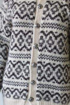Hand knitted wool in a geometric Nordic Fair Isle type pattern. Oversized, boxy fit. Warm and cozy - a great layering piece for fall and winter. Label: Stobi. Made in Denmark.