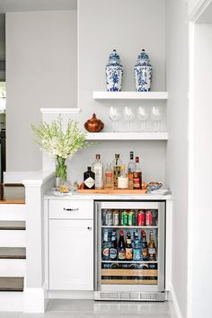 Corner Bar - The 19 Most Incredible Small Spaces on Pinterest - Southernliving. When it comes to efficient design, no space goes unused. This corner by the stairs is transformed into an official drink station thanks to some open shelving and smart countertop styling.   See Pin