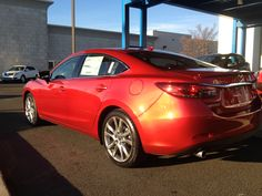 Soul Red Paint in the Sun on the 2014 Mazda6! Wow, look at those colors pop :)
