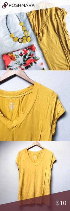V-Neck Mustard Tee Mossimo's V-Neck Tee is silky soft and a classic wardrobe staple; dress it up with a skirt or down with jeans! This top is mustard yellow and in like-new condition.  ✅Price Firm Unless Bundled ✅Ask About Bundle Special 4 Items $10 & Under 🚫Trades 🚫Off-Posh 🚫Modeling  💞Shop with ease; I'm a Suggested User.💞 Mossimo Supply Co. Tops Tees - Short Sleeve