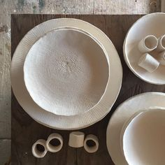 Dinnerware ready for glaze #studiolife #glazeday #servingware #stoneware #dinnerware #white #whiteceramic #tableware #tabledecor #pottery #props #goldcoast #burleigh #bowl #plates #napkinrings #flatlay #australianceramics #handmade #handbuilt #homewares #handcrafted #handmadeceramics