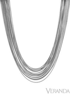 The multiple layers in David Yurman's Box Chain necklace drape gracefully around the neck.