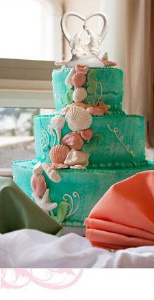 I need this creative ocean themed cake for my birthday in three days! I am obsessed with everything ocean. I love the color of the fondant and I like how the sea shells and starfish rise up onto the cake!!! Such a well made cake!!!!!!!!