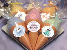 I am thinking baby shower basket full of these!  Wrap up onesies, socks, washcloths etc. and present gift in cones!