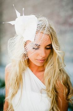 Consider a fun take on the classic birdcage veil | Sara Norrehed Photography