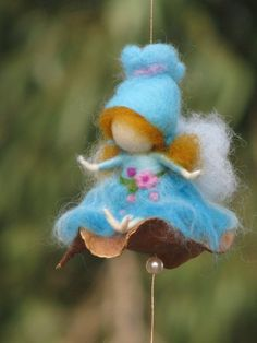Needle felted fairy swings on a seed by Made4uByMagic on Etsy ♡
