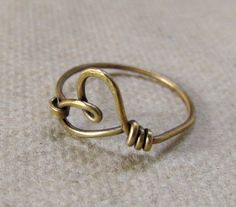 Heart Ring, simple, casual, red brass wire, texture, hammered, oxidized. $13.00, via Etsy.