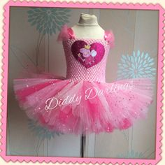 Peppa Pig Tutu Dress.Beautiful & lovingly handmade. All characters and colours available Price varies on size, starting from £25. Please message us for more info. Find us on Facebook www.facebook.com/DiddyDarlings1 or our website www.diddydarlings.co.uk