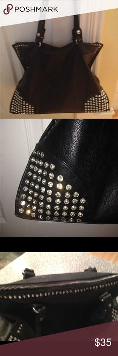 MMS black leather pocketbook  large rhinestones Gently used large leather handbag with large rhinestones on both ends on the bottom of the front of the handbag. None missing. Top has a full zipper as shown in the pics. No signs of wear. Has a back zippered pocket and inside the bag there are pockets, including one for a cell phone. Nice classic bag! MMS Design Studio Bags Shoulder Bags