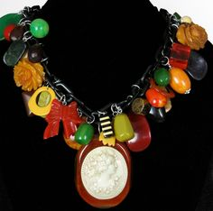 Vintage Bakelite Charm Necklace  - FREE SHIPPING. $729.00, via Etsy.