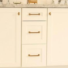 White Cabinets with Brass Hardware- bathrooms
