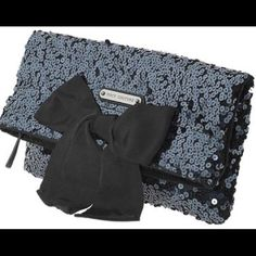 Barely used sequin bow clutch Gorgeous navy sequin clutch with enough room to hold anything you need on a night out! It is in perfect condition! The bow is a bit crinkled from storage but is not noticeable. Make an offer I am always flexible:)                                                       ✅Bundles                                                                        🚫Trades                                                                               ⚡️Fast shipping Juicy Couture…