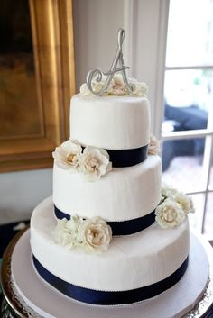 Navy and White Wedding Cake. Love something this simple, and could easily change the ribbon from navy to whatever color pallets the wedding is.