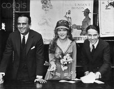 Douglas Fairbanks, Sr., Mary Pickford, and Charlie Chaplin at a World War I Victory Bond Rally. Pickford wears a suit designed by Lady Duff-Gordon (Lucile) for the film The Little American. 1917.